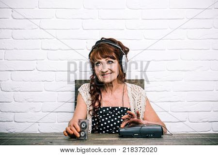 happy granny dj in headset with cassette player. Spy and operator. Audio book and new technology education. Old woman with cassette recorder listen music in headphones. Old school music player radio