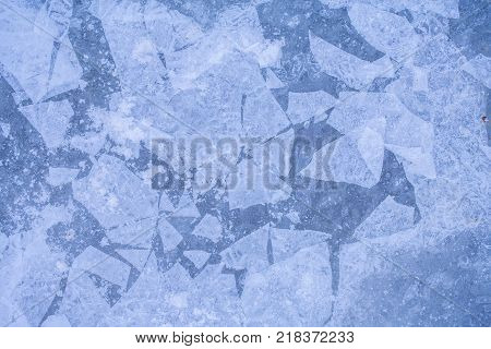 Texture of ice surface. Christmas frozen window texture. Frost crystal border on ice Christmas backdrop. Winter ice background new year. Background with ice frozen texture.