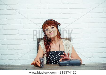 Granny dj in headset with cassette player. Spy and operator. Old woman with cassette recorder listen music in headphones. Audio book and new technology education. Old school music player radio.