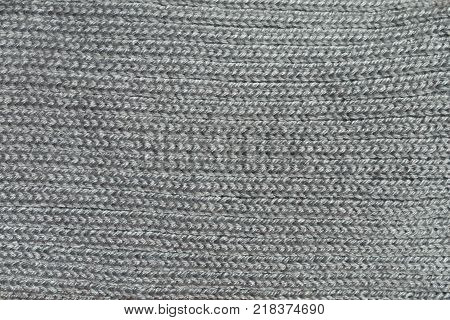Macro of grey handmade rib knit fabric