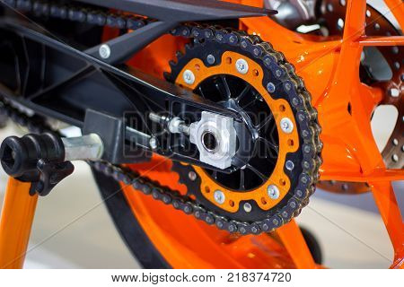 closeup motorcycle chain with rear - wheeled motorcycle