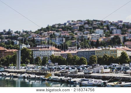 Panorama of the city with cars and boats tilt-shift effect