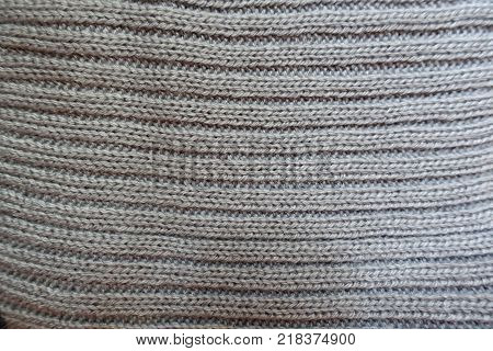 Surface of grey handmade rib knit fabric