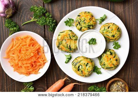 Healthy food. Diet vegetable cutlet from carrot zucchini potato on wooden background. Top view flat lay