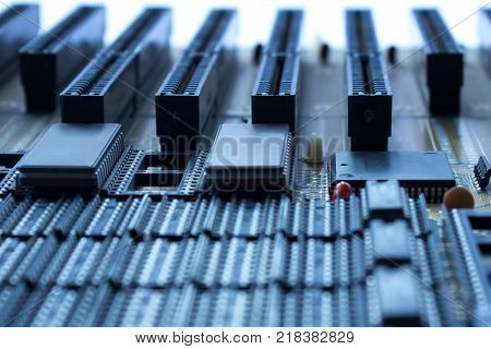 On board are capacitors resistors slots integrated circuits and microprocessor.