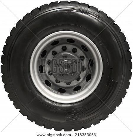 Isolated new rear truck wheel on hub with black shine tire. New clean tractor truck wheel tire. High resolution truck wheel car wheel. Isolated truck wheel