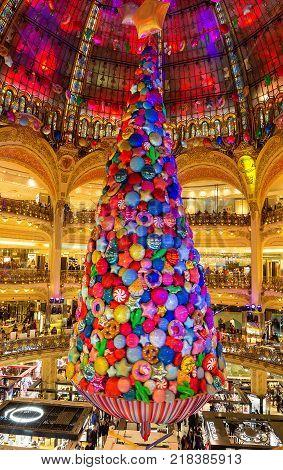 Paris France-13 December 2017: Giant Christmas tree inside Galeries Lafayette Parisian department store located boulevard Haussmann in Paris, France.