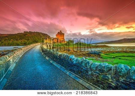 Colorful sunset and twilight on Eilean Donan, 13th Century Castle of United Kingdom. Located in Dornie village in the Highlands of Scotland.