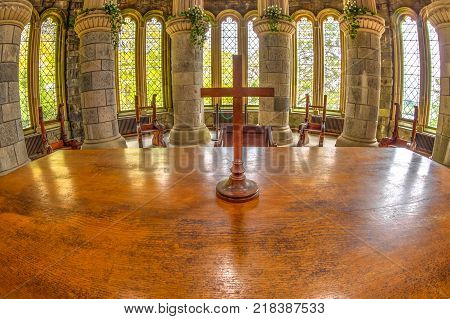Argyll, Scotland, United Kingdom - June 1, 2015: wooden cross on the main altar of Saint Conan's Kirk gothic church, on Loch Awe lake in Argyll town of Scotland in Scottish highlands.