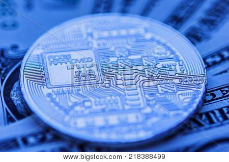 cryptocurrency coin close-up, over us dollar background