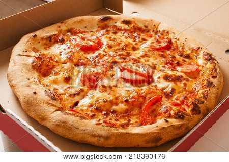 Vegetarian fast food. Margaretha or margarita margherita pizza texture in pizza box. Pizza without meat. Tasty delicious pizza. Piia delivery banner ad background. With box.
