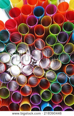Fancy straw art background. Abstract wallpaper of colored fancy straws. Rainbow colored colorful pattern texture. Artsy colorful abstract wallpaper.