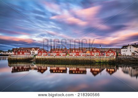 Sunset over harbor houses in Svolvaer. Svolvaer is located  in Nordland County on the island of Austvagoya in Lofoten, Norway. Long exposure.