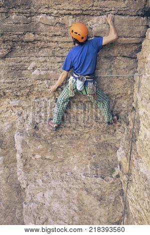 The climber climbs the rock.The climber climbs the rock.