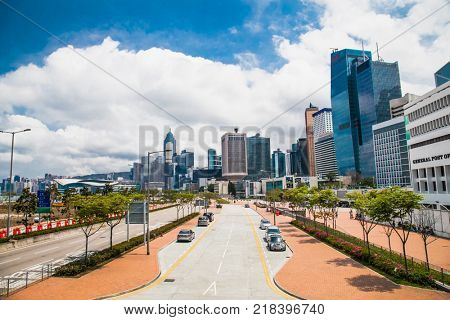 HONG KONG, CHINA - APR 4, 2016: Inner city street with modern skyscrapers on background on Apr 4, 2016, Hong Kong, China.