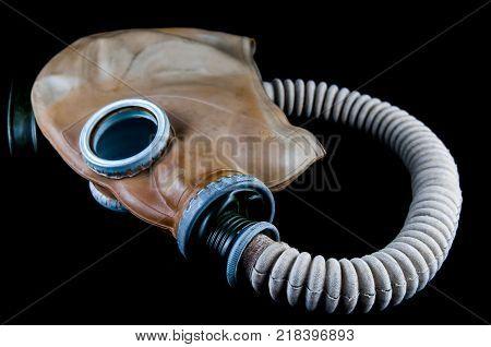 Vintage European  gas mask isolated on black background