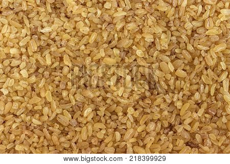 Grains of bulgur (granulated wheat) close-up. View from above. Background texture. The concept of proper nutrition and healthy lifestyle.