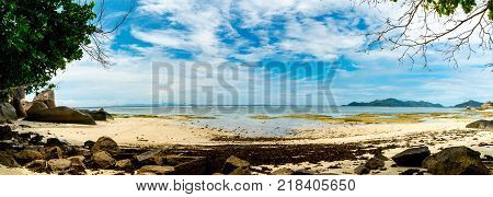 Natural coral reef in front of a tropical paradise beach with white sand and big rocks Anse Source D'Argent La Digue Seychelles