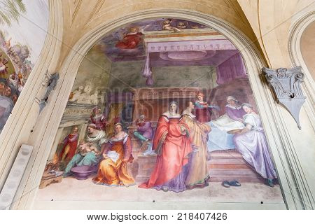 Florence Italy - April 06 2017: Fresco in inner courtyard of the Basilica della Santissima Annunziata (Basilica of the Most Holy Annunciation)