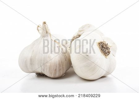White garlic garlics on isolated white studio background. Closeup photo. Clipping path. Easy to use. White background. Cutout cut out.