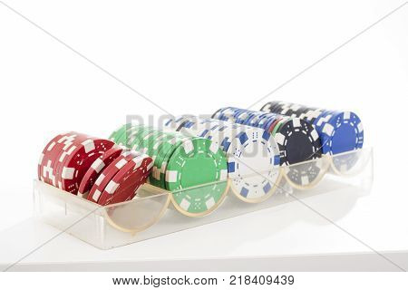 Poker casino coins token tokens on isolated white studio background. Closeup photo. Clipping path. Easy to use. White background. Cutout cut out.