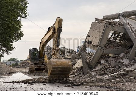 Collapsed industrial building with a huge shovel excavator.