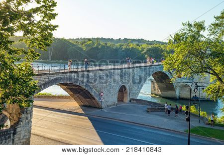 Avignon France - August 25 2016: Visitors on the St Benezet bridge also known as the Bridge of Avignon on the Rhone river