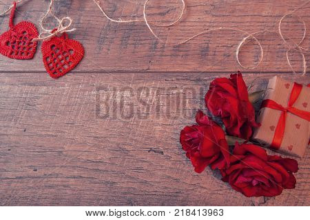 Valentines day background with red roses. Valentine's day table place setting. Wedding background. Mother's, Valentines, Women's Wedding Day concept.