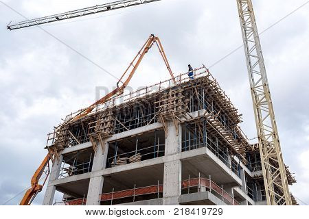 A new building is being constructed with use of tower crane