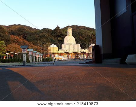 A view of the Kannon Memorial during the sunset. It has colours of the autumn..