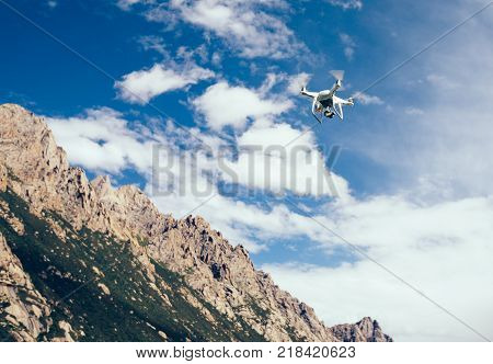 drone flying in the air over high altitude mountains