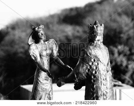BUDAPEST, HUNGARY - DECEMBER 3, 2016: Bronze Statue of King Buda and Queen Pest on Gellert Hill, Budapest, Hungary. Black and white image.