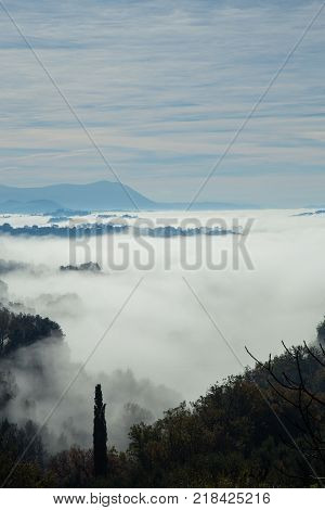Sabina hills immersed in the fog. Italy.