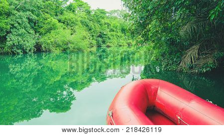 Red Inflatable Boat And The Green Waters Of Formoso River