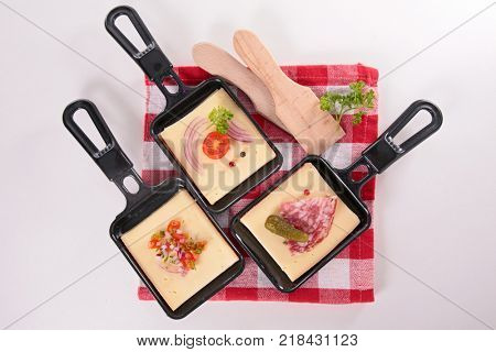 spoon with raclette cheese