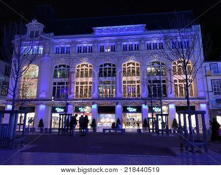 Clermont-Ferrand Auvergne France, 1st December 2017: Night view of Galeries Lafayette de Jaude on Place de Jaude square in Clermont Ferrand