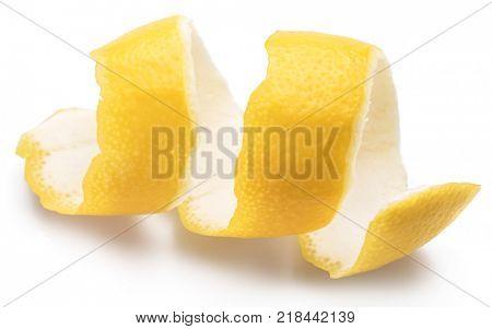 Lemon peel or lemon twist on white background. Close-up.
