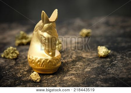 Vintage Chess Horse In Gold And Gold On Old Stone Floor. Conception Of Prosperity