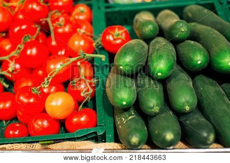 Tomatoes And Cucumbers in boxes At The Supermarket