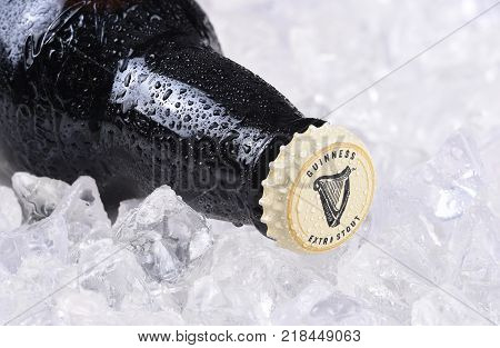 IRVINE CA - December 15 2017: A bottle of Guinness Extra Stout on a bed of ice. The Irish beer is one of the worlds most successful beer brands with annual sales over 850 million liters.