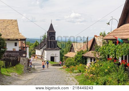 Visitors stroll along the Kossuth Street in the UNESCO World Heritage village - Holloko, Hungary, 13 July 2011