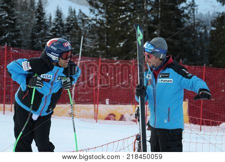 VAL GARDENA, ITALY - DECEMBER 14:  Coach Scotty Venis from Team USA with Steven Nyman of The USA during pre race course inspection for the Saslong course during the Audi FIS Alpine Ski World Cup Men's