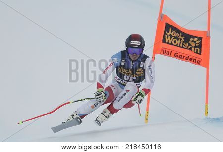 VAL GARDENA, ITALY - DECEMBER 14: Gilles Roulin of Switzerland races down the Saslong course during the Audi FIS Alpine Ski World Cup Men's Downhill training on December 14 2017