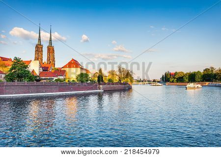 Picturesque scene of famous Tumski island with cathedral of St. John on Odra river. Colorful spring landscape in Wroclaw Poland Europe. Artistic style post processed photo.