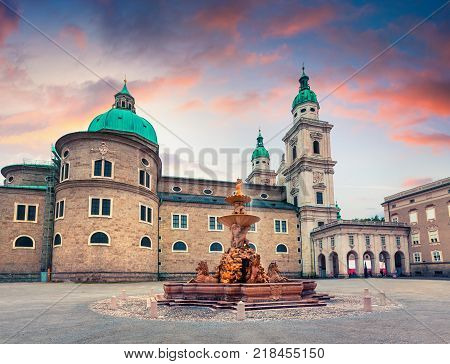 Colorful spring viev of Residenzplatz. Splendid sunset in Salzburg with Baroque fountain and Dom Cathedral Austria Europe. Artistic style post processed photo.