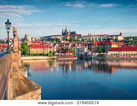 Colorful morning view of Charles Bridge Prague Castle and St. Vitus cathedral on Vltava river. Sunny spring scene in Prague Czech Republic Europe. Artistic style post processed photo.