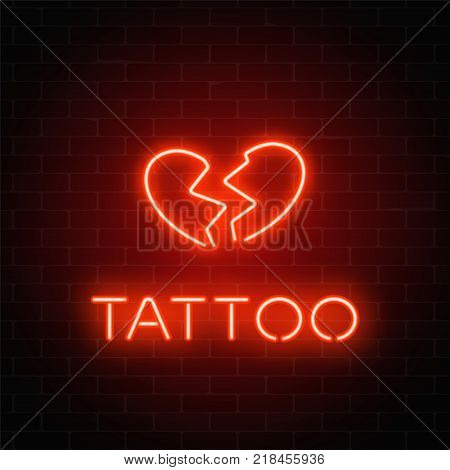 Tattoo parlor glowing neon signboard with emblem. Broken heart glowing logo on a brick wall background. Vector illustration.