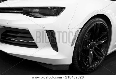 Sankt-Petersburg Russia July 21 2017: Front view of a yellow Chevrolet Camaro 2017. Car exterior details. Black and white. Photo Taken on Royal Auto Show July 21