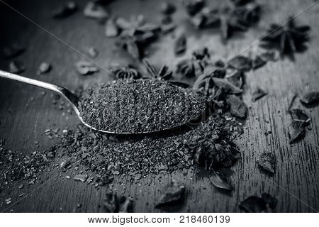 Close Up Star Aniseed,illicium Verum Powder In A Antique Spoon.
