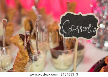 Holiday Party food dessert buffet decorated festively with Cannolis served in individual servings